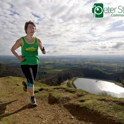 Sarah Grout running on the Malvern Hills, photographed for Trail Running Magazine
