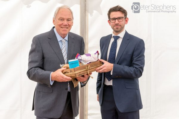Peter Sissons receiving a gift for opening Abercromby house